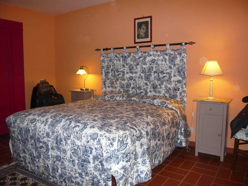 Camera da letto - VENDESI CASALE IN PIETRA CON PISCINA IN MAREMMA